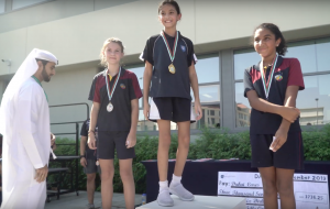 Students collect their medals on the dais.