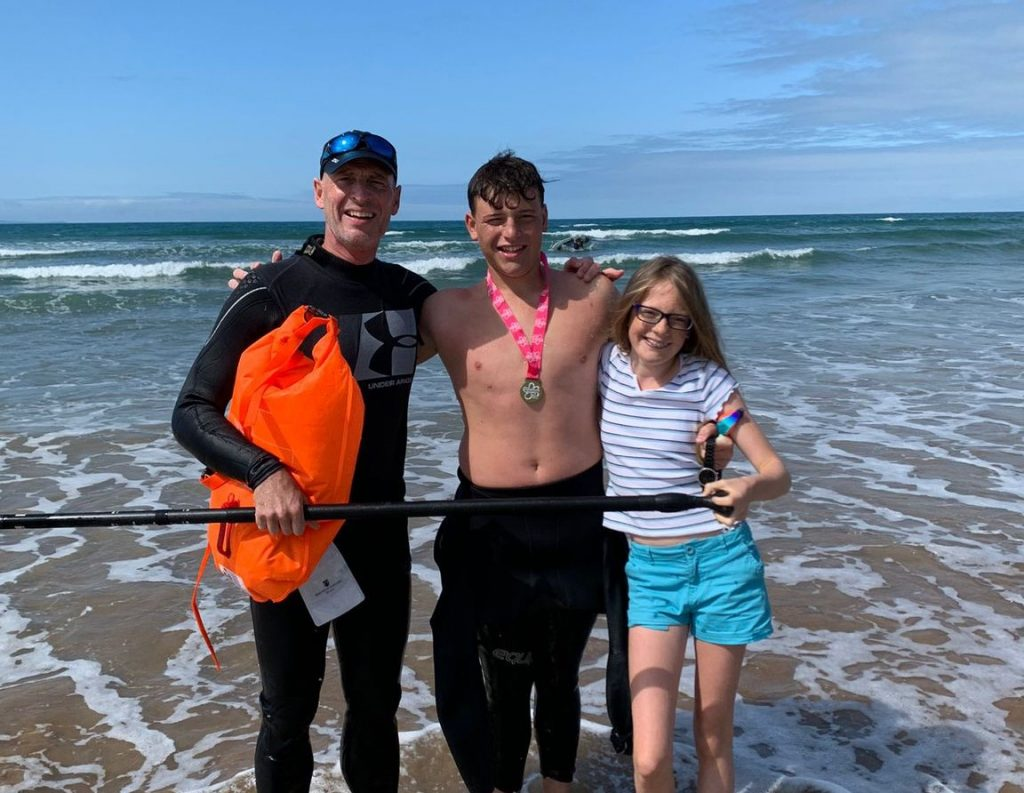 Barney Completes Open Water Swim for Charity